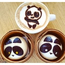 Chocolate Custard & Red Bean Panda Baos w a Panda Cappuccino.