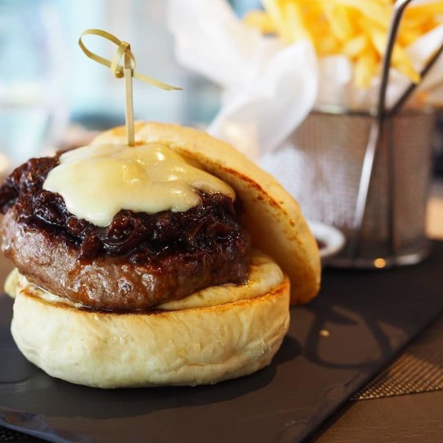 &made's b burger ($20) comes with a dry aged beef Patty, comte cheese, garlic mayo and caramalized onion.