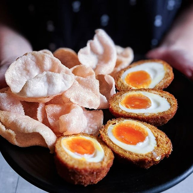 Located at a cozy corner in Timbre+, newly opened @crack.sg serves a localized scotch egg that's really all kinds of delicious.