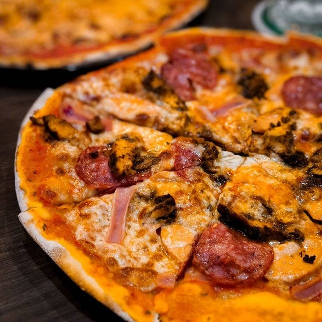 Blasted in a wood-fired oven, the pizzas at Modesto's are charred and well-flavored.