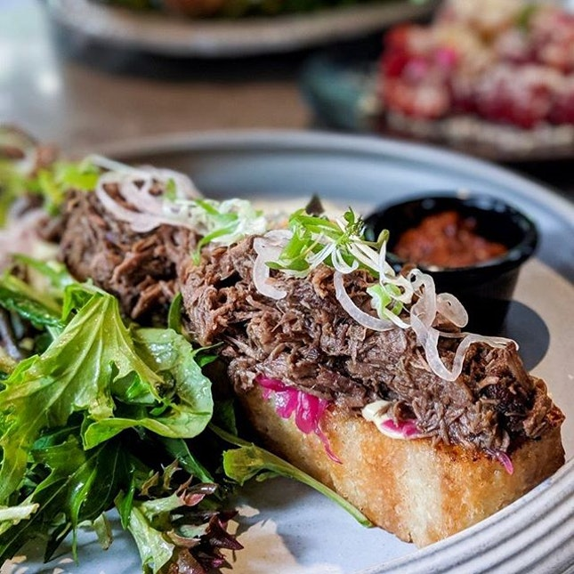 The Braised Beef Open Facer on Open Farm Community's brunch menu sounds innocuous enough but what they don't tell you is that this open facer is also the length of a hoagie roll making the $28 you're paying a very fair price.