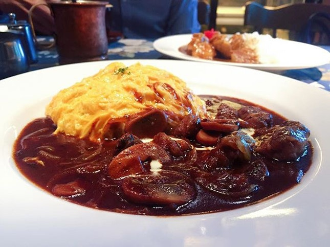 Ma Maison  Beef Stroganoff Omurice $16.80+  The butter rice wrapped with fluffy egg accompanied by succulent beef topped with brown sauce.