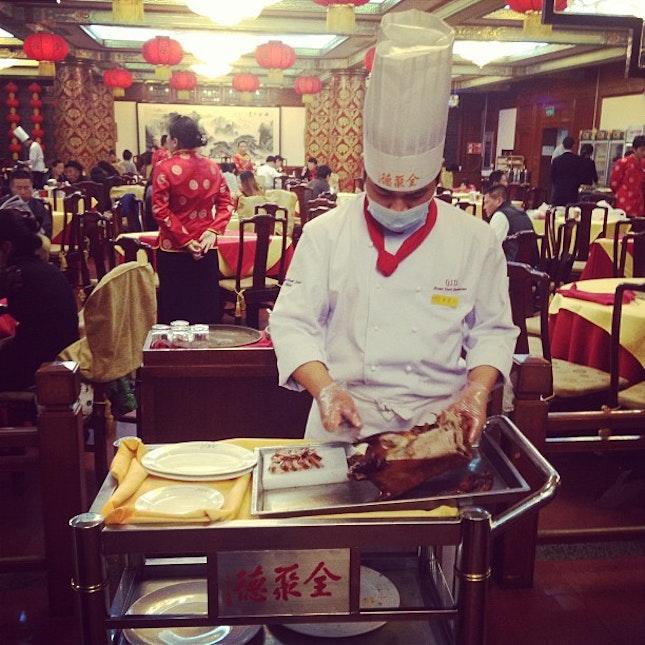Chef preparing Peking duck