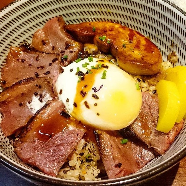 Foie Gras Truffle Yakiniku ($23)  Pan-seared US black angus short ribs, foie gras, onsen egg, truffle soy and black garlic brown butter over Tanuki Raw's signature rice 🍚 Tender ribs and foie gras just melts in my mouth 😋 Breaking the onsen egg to let the yolk ooze out on top of such flavourful rice is the way to go!