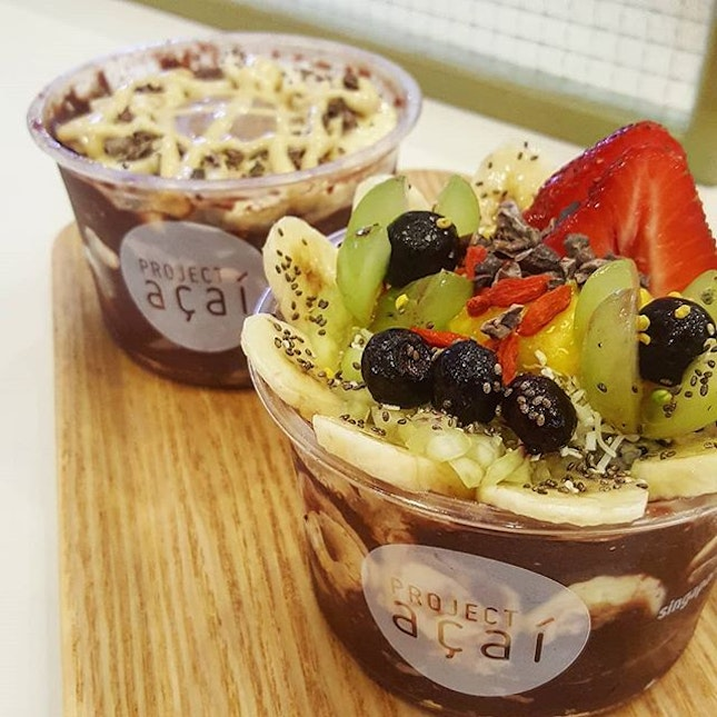 Pretty Signature Acai Bowl topped with lots of fruits 🍌🍓, and another with cashew and almond butter (both at $14.50 each for L).