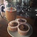 coffee in a mug w/ my chunky banana chocolate chip cupcake.