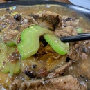 Black soya sauce hor fun top with slices of beef and bitter gourd!