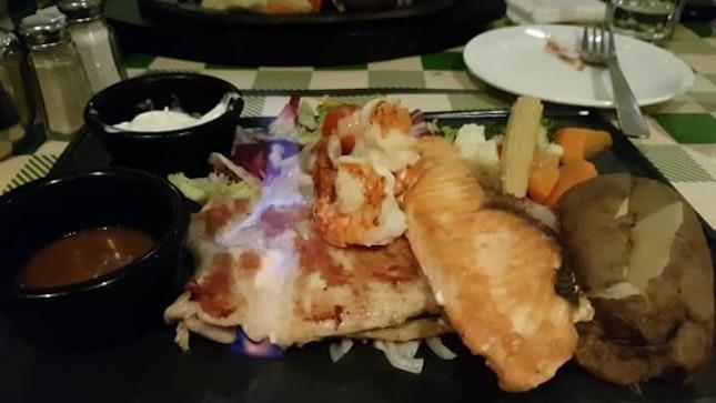 Flambeau chicken steak with salmon and sea prawn #sgfood #sgfoodies #yummy #sg #burpple #burpplesg #dinner #foodlover #food #foodporn #instafood #justeatlah #jacksplacesg @jacksplacesg
