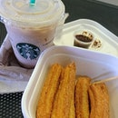 Churros and coffee.