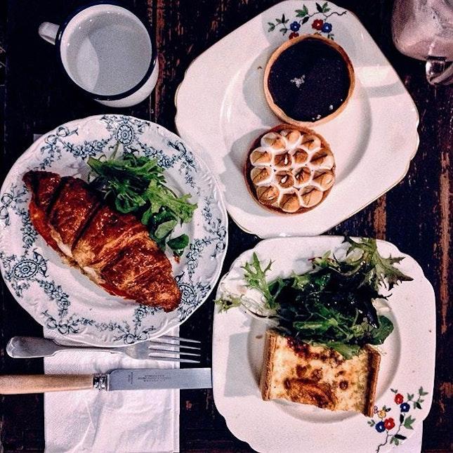 Carpenter & Cook's Quiche w/ salad ($7.50), Croissant ($5.00), Sea Salt Chocolate Tart ($6.50) and Lemon Meringue Tart ($6.50).