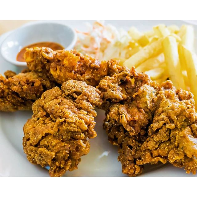 Southern-style Deep-fried Buttermilk Chicken with Slaw + Fries Not your usual chicken cutlet at your western food restaurant.