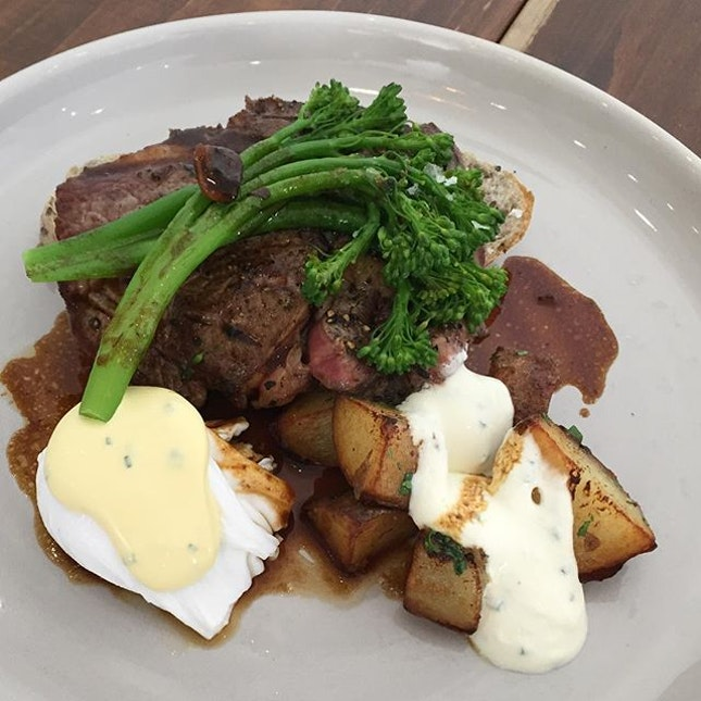 Steak & Eggs ($19.90) 🍽 150g juicy & tender rib eye steak, tasty potatoes topped with sour cream, soft smooth free range poached eggs & chive hollandaise.