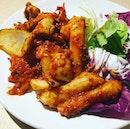 Dak Galbi ($12) Stir fried chicken & rice cake with Kimchi sauce.