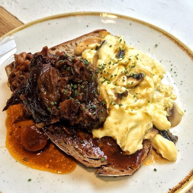 Gyu & Tama ($17) — Mushroom-scrambled eggs, semi-dried tomatoes, 24-hour braised beef cheek, toast