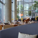 A comfy lounge seat at the restaurant atop the OUE building, ME@OUE.