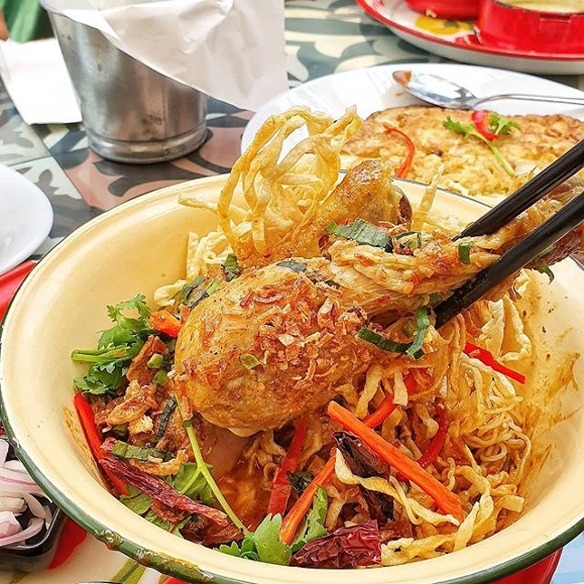 Khao Soi, a Northern Thailand egg noodle dish with curry gravy, and crispy fried noodles and shallots adorning this.