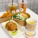 Zoey's diner serves modern baos and burgers with healthier sides option and fast food concept.