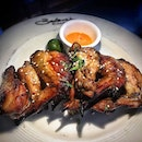Baked chicken wings SGD 9.90++.