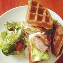 Crispy Waffles Sandwich with Ham, Bacon, Egg and melted cheese.