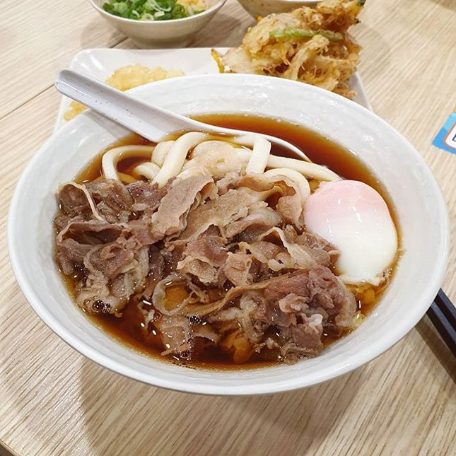 Slurping up this comfort bowl of freshly made chewy Sanuki udon with slices of tender beef.