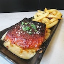 Miso Baked King Salmon w Wasabi Fries ($23) Sashimi grade salmon baked with miso crust and served a little pink.
