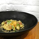 [First25cafe] Appetizer: Gnocchi with Spicy Miso Butter and Bacon.
