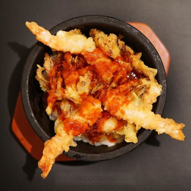 Sizzling hot stone tendon with prawn kakiage and onsen egg in Gochujang chilli sauce.