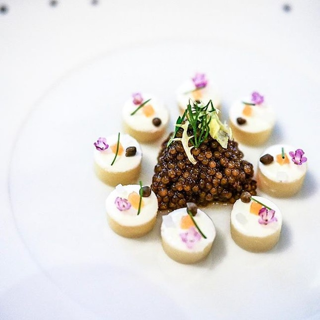 """ La pomme de terre Roseval "" caviar served on petals of roseval potatoes with condiments and fresh herbs ...."