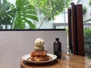 Waffles with ice cream and coffee loving their indoor back seating area.