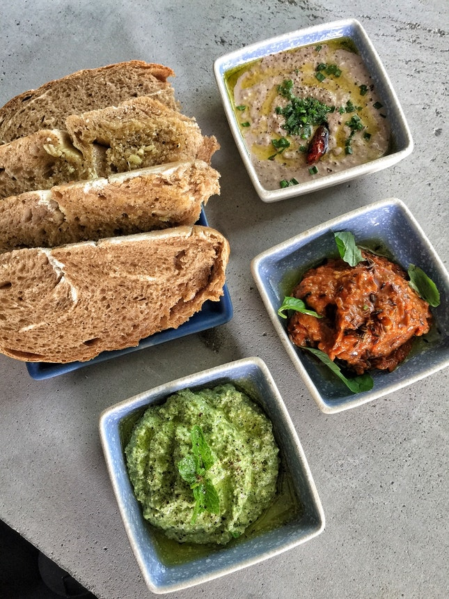 Basil and Feta ($9), Smoked Eggplant and Peppers ($7), & Black Bean Hummus ($8) Dips and Sourdough($4)