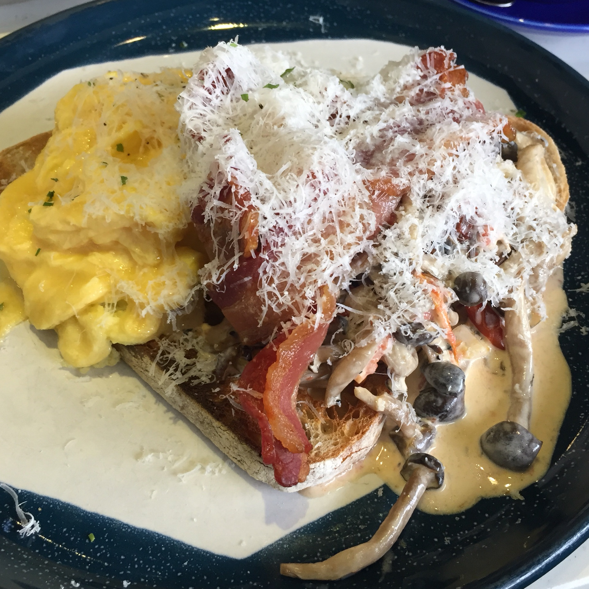 Mushrooms on Sourdough Toast with Scrambled Eggs & Bacon ($20++)