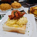 Scrambled eggs w/ Toast & Luncheon Meat ($9.90)