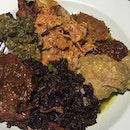 Buah Keluak Fried Rice with Singgang, Beef Rendang, Tripe Sambal & Sweet Potato Leaves at Immigrants.