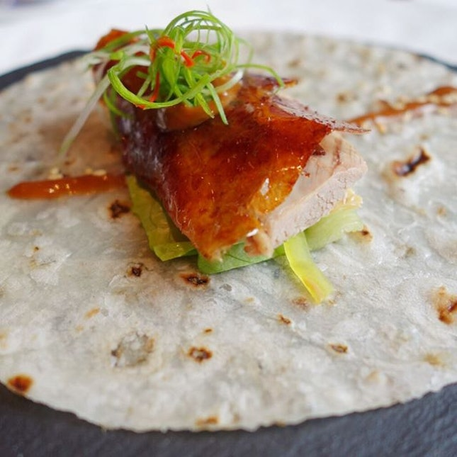 Roast Peking Duck Skin with Crispy Beancurd Skin served in Pita Bread with Sesame Dressing at @tongleprivatedining.
