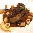 Seared foie gras w hazelnut and chocolate sauce .