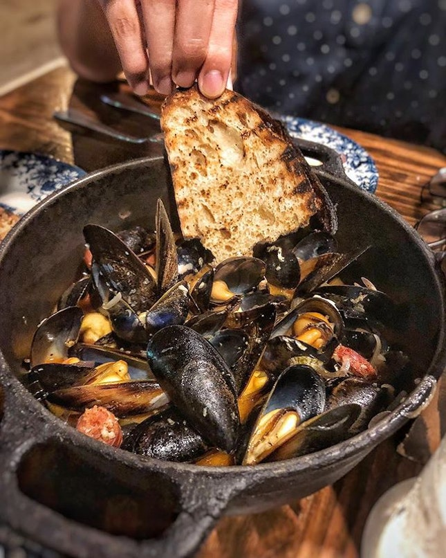 Fat and juicy mussels fill the bowl as we quickly empty out every single shell.