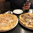 Meat Pizza And Garlic Snowing(??) Pizza