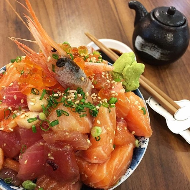 Heaps of sashimi over a bowl of rice.