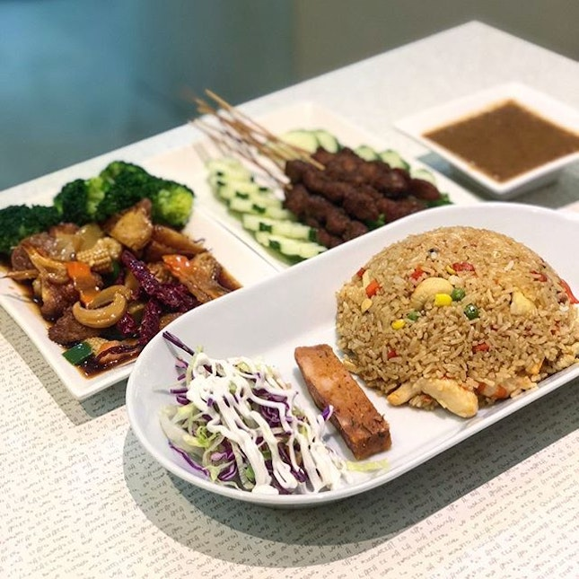 Pineapple fried rice, Kung pao chicken and satay.