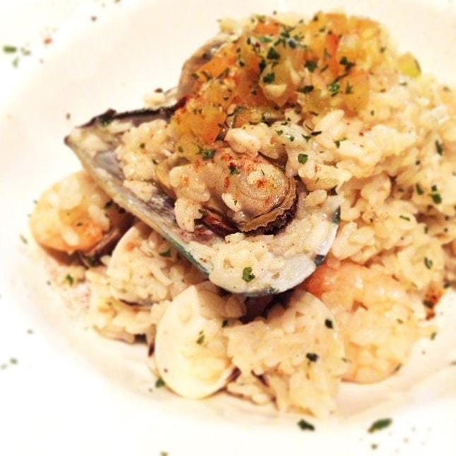 Seafood risotto in cream sauce.