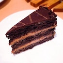 Gloriously moist chocolate cake with caramel mousse, chocolate praline and chocolate chips.