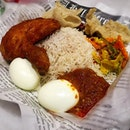 Signature Nasi lemak Pretty good nasi lemak which uses bismatic rice.