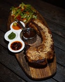 Signature Grilled Pork Tomahawk Helmed by renowned Chef Heman Tan, this is a Masterpiece.