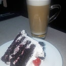 Steaming mug of Hazelnut Latte and slice of Blackforest Cake, thats how I got through the day.
