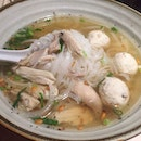 Chicken Pho - clear light broth with gentle hints of spices, pooling satin-textured rice noodles, tender chicken slices and bouncy chicken balls.