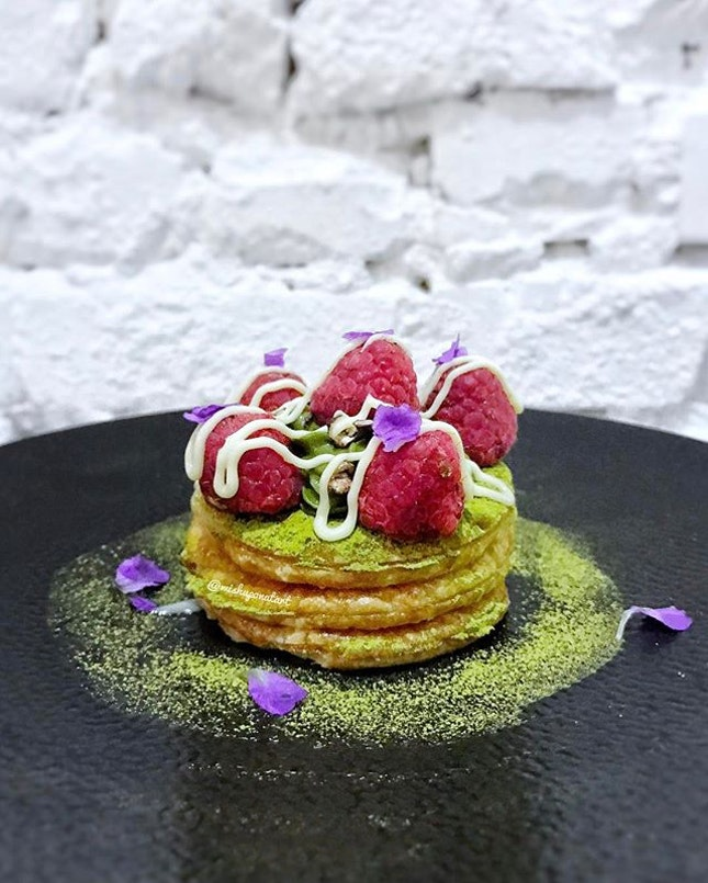 Layers of crispy puff pastries showered with green tea powder and topped with white chocolate glaze, red beans and raspberries.