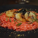Pretty pink risotto ($26) consists of seafood-simmered risotto in natural colouring (beetroot) topped with succulent pan-seared scallops.