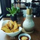 Wedges w Ice Mocha in Light-bulb bottle  #food #wedges #fried #mocha #cafes #foodies #café #lunch #break #snack #snacks #foodie #foodstagram #foodporn #potatoes #potato #instalike #foodshot #foodphoto #foodphotography #foodphotographer #eeeeeats #instadaily #photooftheday #photoofday #photooftheweek #containercafe #mycafefood #instafollow #burpple
