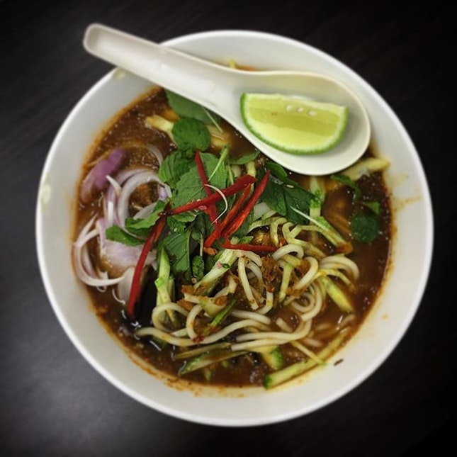 My sister was slurping up this bowl of Assam Laksa with extra Hae Koh.