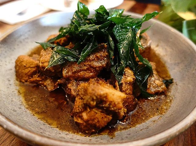 Black pork curry, so it says on the menu.